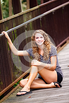 Pretty Teenage Girl Sitting On A Bridge Royalty Free Stock Image - Image: 24798146