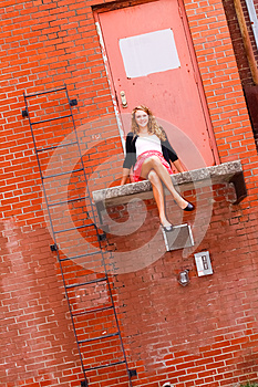 Pretty Teenage Girl Sitting On A Ledge Stock Photo - Image: 24798180