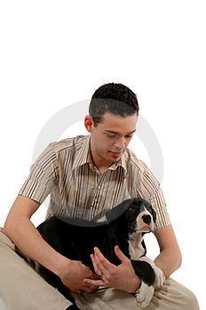 Young man looks at his dog Royalty Free Stock Photography