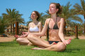 Tropical yoga girls Royalty Free Stock Photography