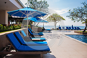 Sun Bathing Chair At Swimming Pool Royalty Free Stock Images - Image: 24855919