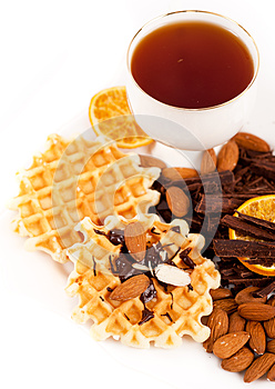 Sweet Waffles With Chocolate, Nuts And A Cup Of Te Royalty Free Stock Image - Image: 24915366