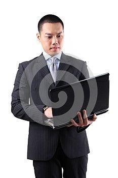 Young Asian Businessman Holding Laptop Stock Photos - Image: 24922073