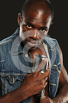 Young African American Singer With Microphone Stock Photography - Image: 24951222