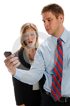Young Businesspeople With Cell Phone Stock Image - Image: 24952241
