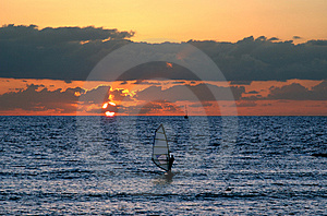 Windsurfing At Sunset Stock Images