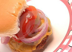 Cheeseburger With Condiments Free Stock Photography