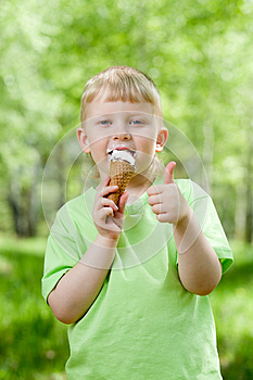 Kid Eating A Tasty Ice-cream Outdoor With Thumb Up Royalty Free Stock Photos - Image: 25061558