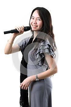 Karaoke Singer On A White Background. Royalty Free Stock Photo - Image: 25061965