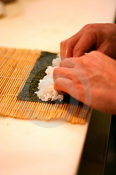 Chef Rolling Sushi Roll 2 Royalty Free Stock Photo