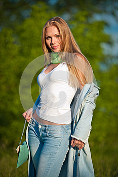 Portrait Of Beautiful Young Girl In Jeans Outdoor Royalty Free Stock Photo - Image: 25126445
