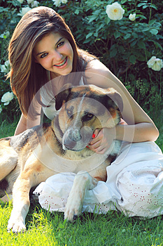 Smiling Teenager With Her Dog Stock Image - Image: 25153991