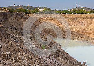 Soil Avalanche Of The Pond. Royalty Free Stock Image - Image: 25177926