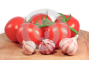Fresh Tomatoes And Garlic Royalty Free Stock Photo - Image: 25185105