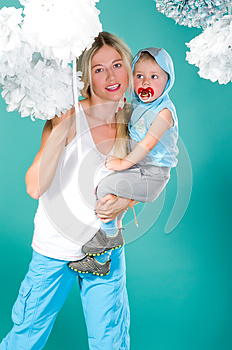 Mom Holds Her Son In Her Arms Royalty Free Stock Photo - Image: 25227345