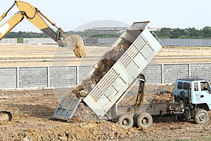 Backhoe And Dump Truck Stock Photo - Image: 25281740