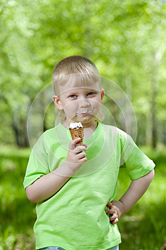 Kid Eating A Tasty Ice Cream Outdoors Royalty Free Stock Photos - Image: 25282788
