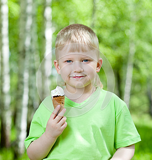 Child Eating A Tasty Ice Cream Outdoors Royalty Free Stock Image - Image: 25282896