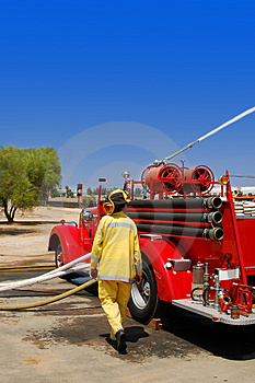 Vintage Fire Truck & Fireman Royalty Free Stock Image - Image: 2530856