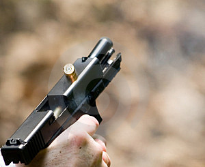 Pistol in Action Stock Photo