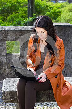 Young Woman Sitting On A Bench Royalty Free Stock Photography - Image: 25338237