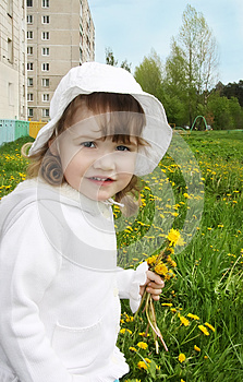 Cute Little Girl Holds Yellow Dandelions Royalty Free Stock Photography - Image: 25346267