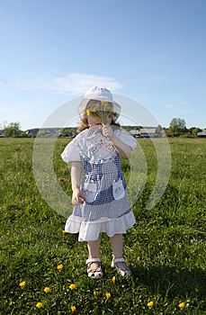 Little Girl Hides Her Face In Yellow Dandelions Stock Photography - Image: 25350792