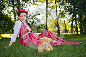 A Young Pregnant Girl Sitting Royalty Free Stock Images - Image: 25361659