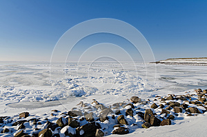 Frozen Lake With Crushed Ice Sheet And Rocks Stock Photo - Image: 25363070