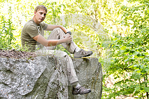 Man On The Edge Of A Cliff Stock Images - Image: 25364374