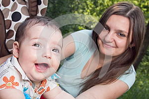 Young Mother With A Charming Baby Stock Photos - Image: 25364603