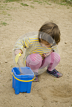 Child Playing In The Sand Stock Photo - Image: 25371810
