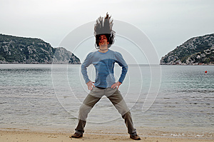 Man With Long Hair On The Beach Royalty Free Stock Photo - Image: 25376575