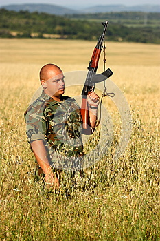 Soldier In A Field Stock Image - Image: 25396391