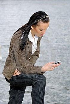 Businesswoman Reading SMS Stock Photos - Image: 2546283