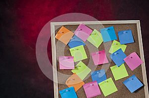 Red Dangerous Background With Cork Board Full With Colored Post Notes Royalty Free Stock Images - Image: 25522459