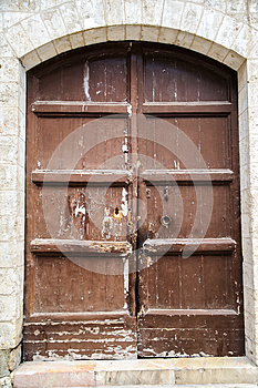 The Wooden Door On The Old Walls Royalty Free Stock Photo - Image: 25555145