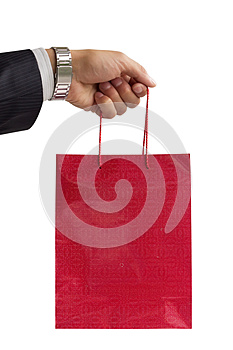 Businessman Holding Red Gift Bag Royalty Free Stock Photo - Image: 25597175