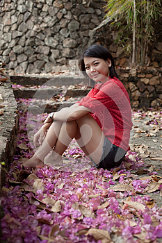 Asian Woman Sitting On Ground With Paper Flowers Royalty Free Stock Photo - Image: 25599895