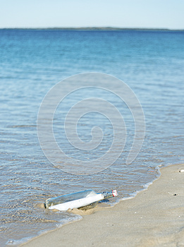 Message In A Bottle On A Deserted Beach Royalty Free Stock Photos - Image: 25667258