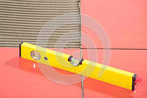 Level Red Tiles On A Floor Tile Adhesive Stock Photo - Image: 25670650
