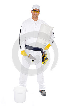 Worker In Overalls Bucket Trowel Package Royalty Free Stock Photo - Image: 25671465