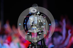 Film Camera In Front Of A Cheering Crowd Royalty Free Stock Image - Image: 25672006