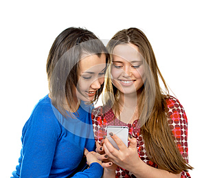 Two Girls Read Messages By Phone Stock Image - Image: 25716021