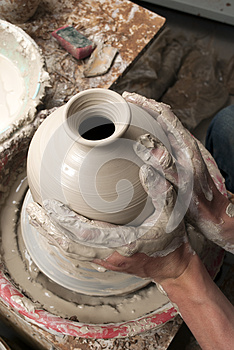 Hands Of A Potter, Creating An Earthen Jar Royalty Free Stock Image - Image: 25718476