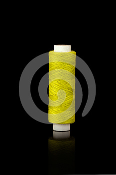 Yellow Spindle Of Yarn Royalty Free Stock Photography - Image: 25721207