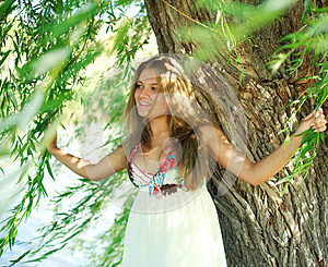 Smiling Girl Under Willow Tree Stock Photos - Image: 25740753