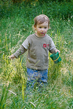 Lovely Child Plays To A Grass Royalty Free Stock Photos - Image: 2589168