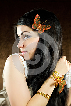 Brunette With Brown-gold Butterfly Royalty Free Stock Photography - Image: 25838587