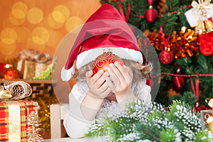 Happy Child Holding Christmas Ball Stock Images - Image: 25860494